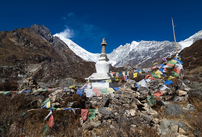 """Buddhist stupa in front of Langtang Lirung Mountain (7227m)"""