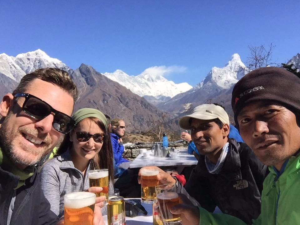 """""""Enjoying a beer with our guides and Mt Everest"""""""